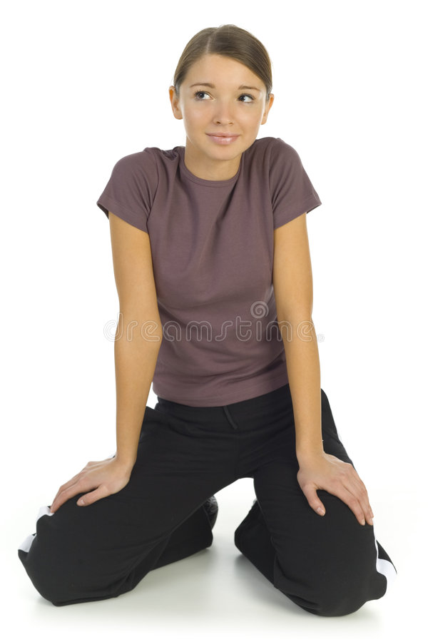 Kneeling woman in tracksuit royalty free stock images