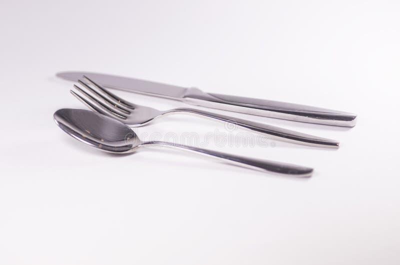Knief de prata da colher da forquilha isolado no fundo branco foto de stock