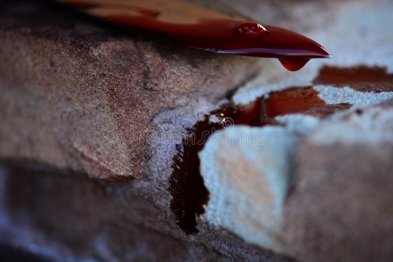 Knife in a blood stock photo