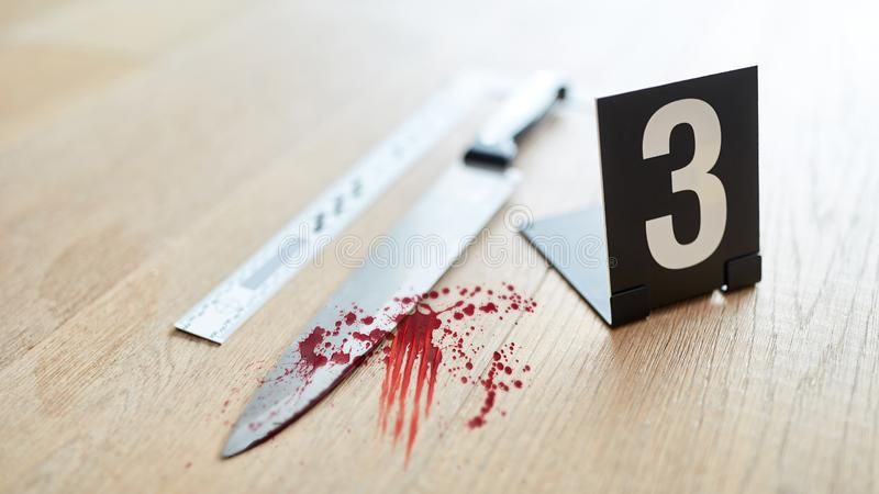 Knife with blood at the crime scene as evidence royalty free stock photography