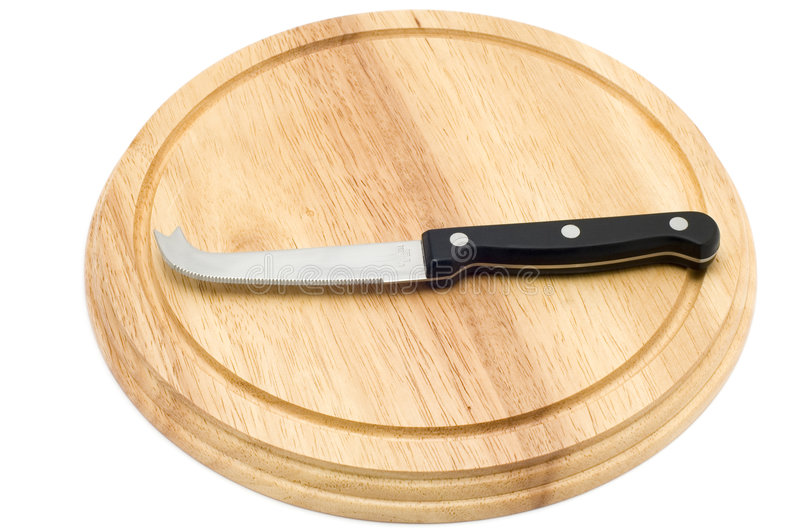 Knife for cheese on board stock photo