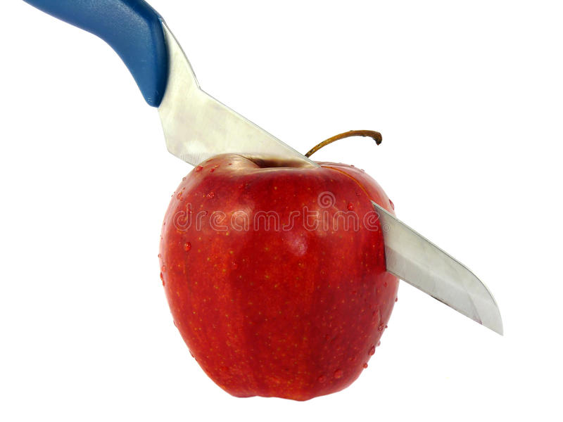 Download The Knife Cuts The Red Apple Isolated Stock Image - Image: 18609799