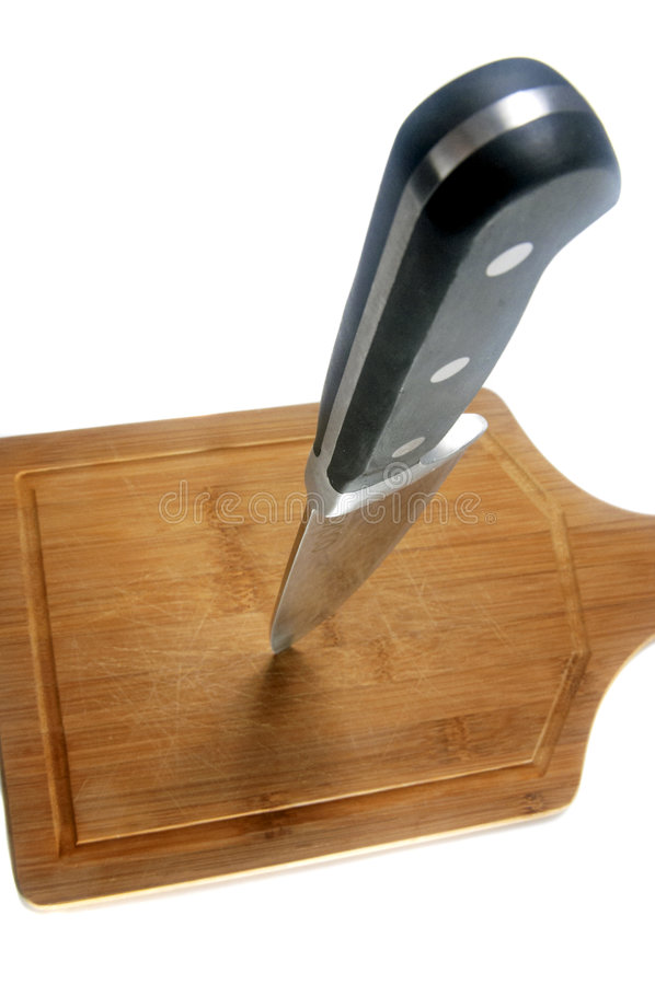Knife in Cutting Board1 royalty free stock photos