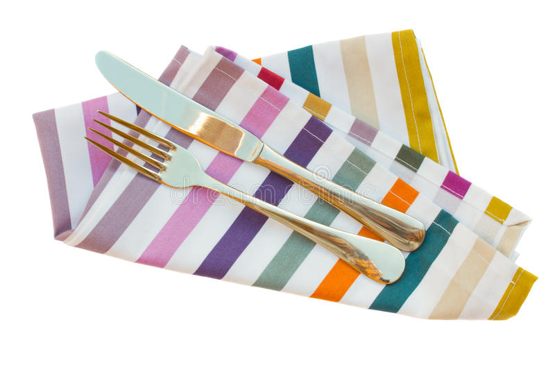 Knife and fork. Close up on napkin isolated on white background stock photo