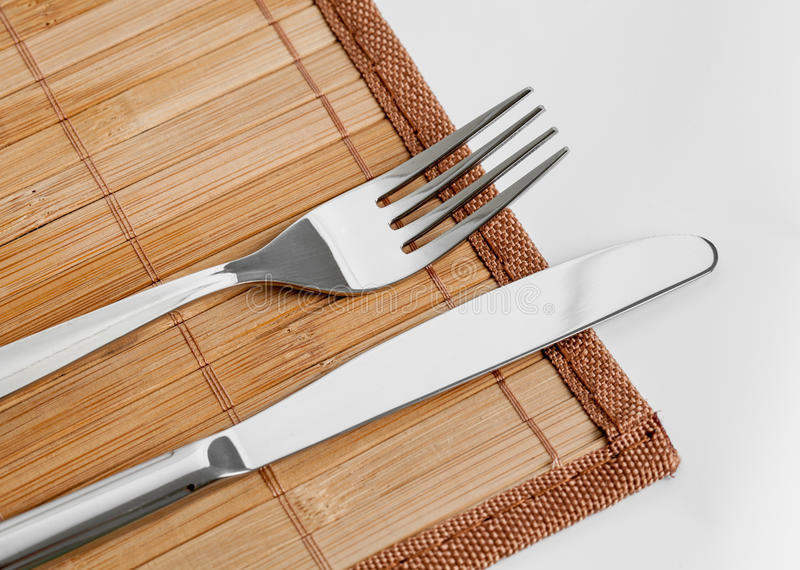 Download Knife And Fork On Bamboo Tablecloth Stock Image - Image of dishware, place: 26534977