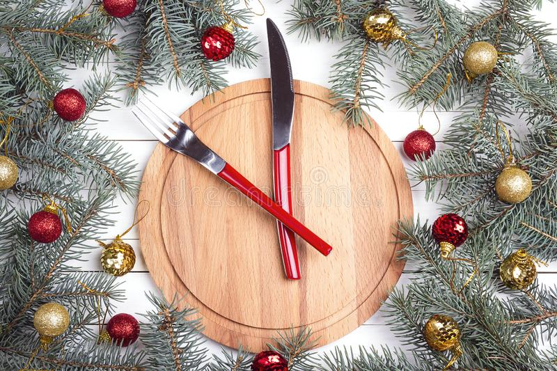 Knife and fork instead of the clock on round wooden cutting boar royalty free stock images