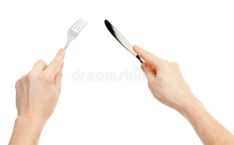 Knife and fork cutlery in hands isolated royalty free stock photos