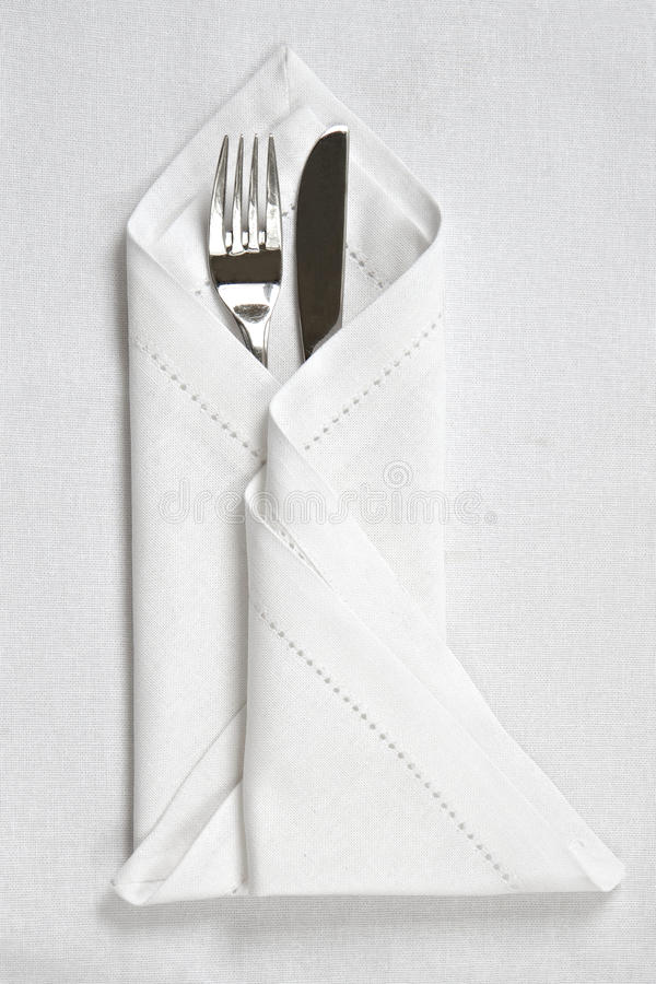 Knife And Fork With Linen Napkin Stock Photo