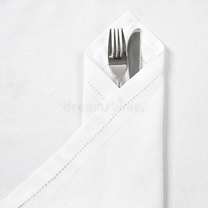 Knife and fork with linen serviette. And space for text stock images