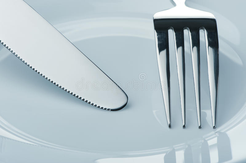 Download Knife And Fork On A Plate Royalty Free Stock Images - Image: 11905929
