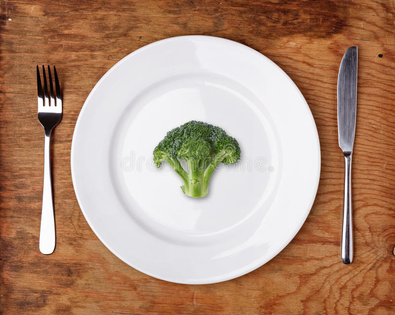 Knife, Fork and plate with broccoli stock photos