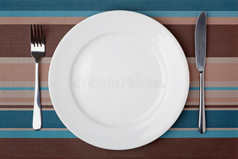 Knife, Fork and plate. stock image