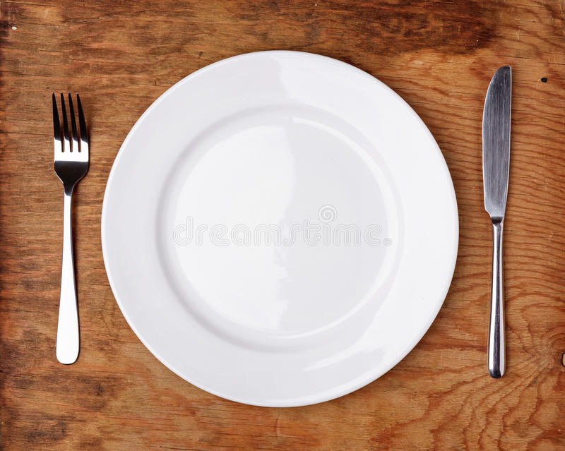 Knife, Fork and plate on table stock images