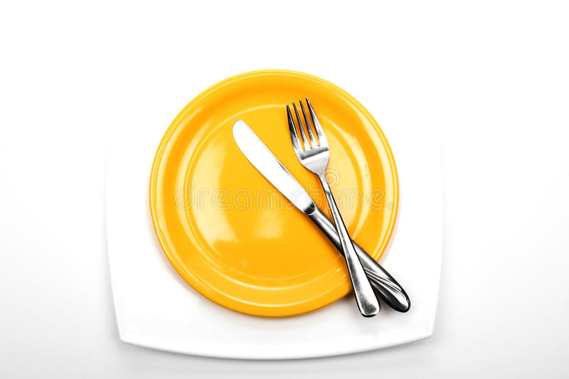 Knife, fork and plates stock photos