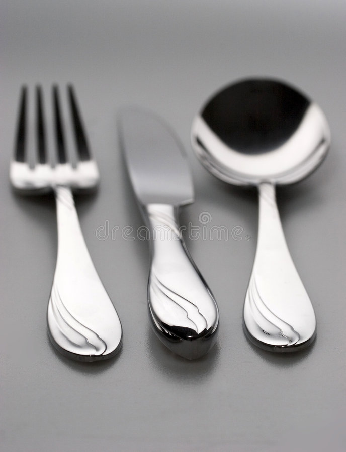 Knife, fork, spoon. Knife, spoon fork with focus on grips stock photo