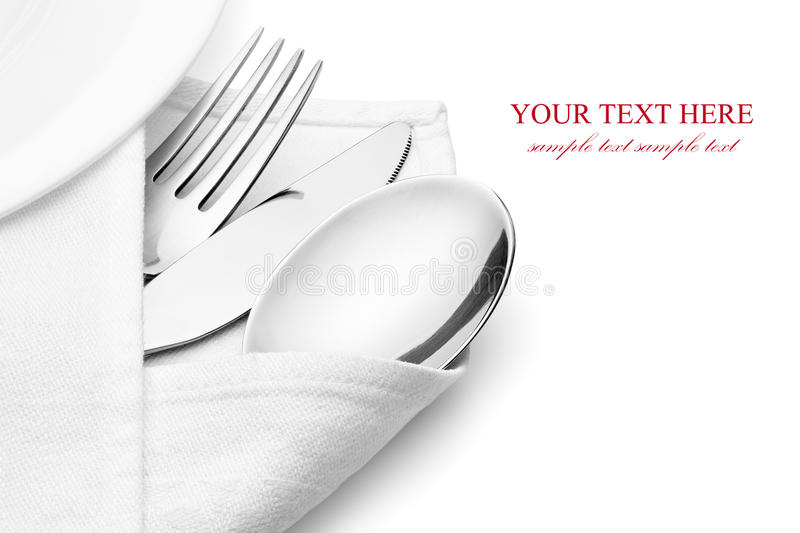Knife, fork and spoon with linen serviette. Knife, fork and spoon with linen serviette, on the white background, clipping path included stock image