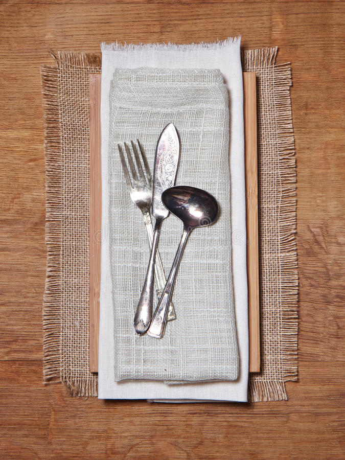 Knife and fork on vintage clothes royalty free stock images