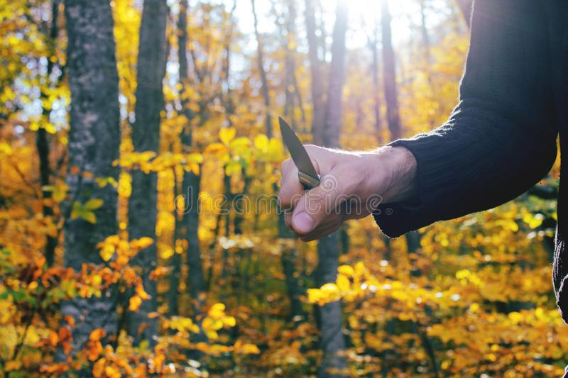 Knife in the hands of a killer or a maniac stock image