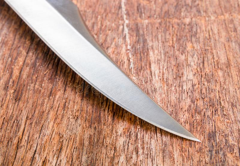 Knife for hiking on wooden vintage background with copy space add text stock image