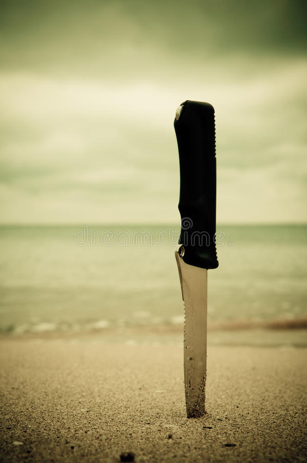 Free Knife In Sand Stock Photos - 13227353