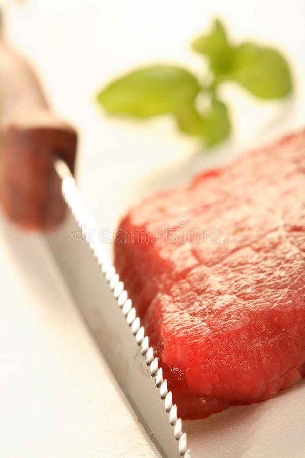 Knife and meat royalty free stock images