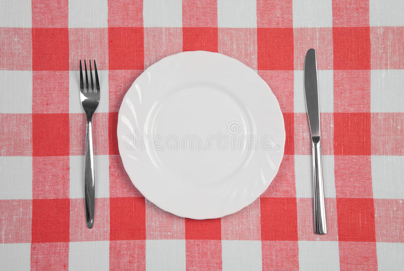 Knife, Plate And Fork Checked Tablecloth Top View Royalty Free Stock Image