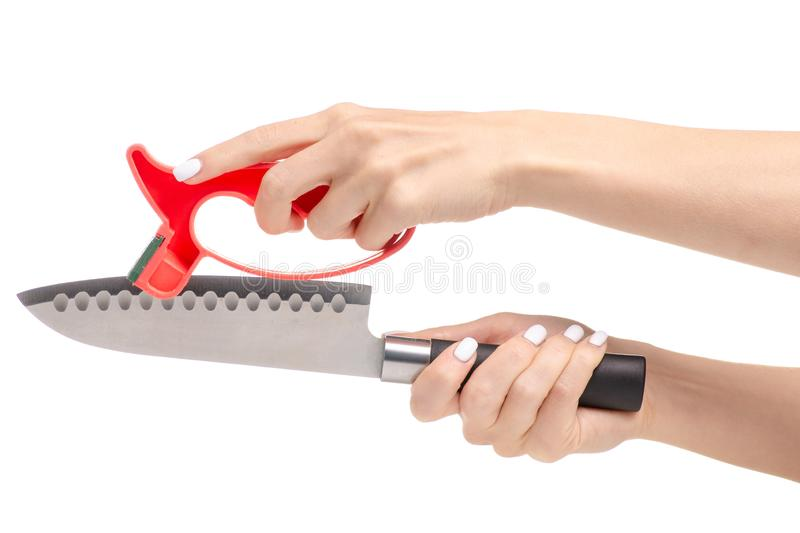 Knife sharpener knife in hand. S on a white background stock photo