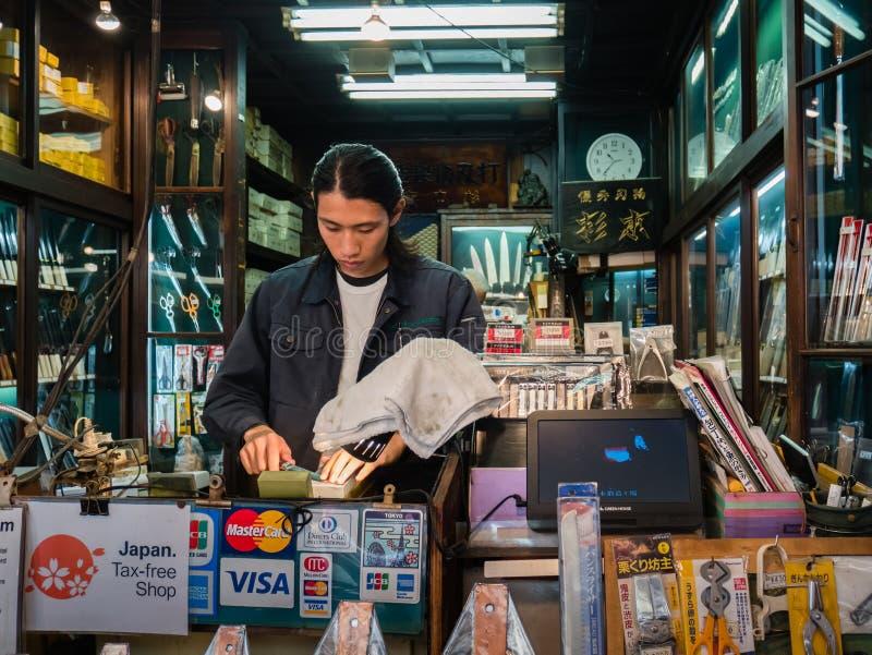 Knife Sharpening at Tsukiji Fish Market in Tokyo royalty free stock image