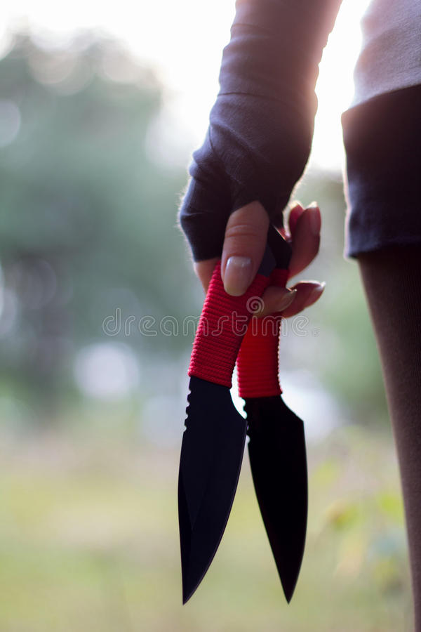 Knife thrower young girl royalty free stock photos