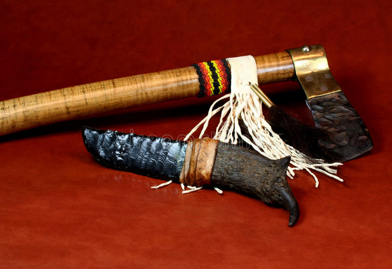 Knife and Tomahawk. Native American Flint Kinfe and Tomahawk royalty free stock images