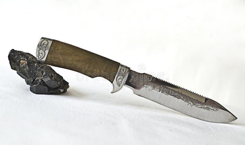Knife and Tourmaline cristall royalty free stock photo