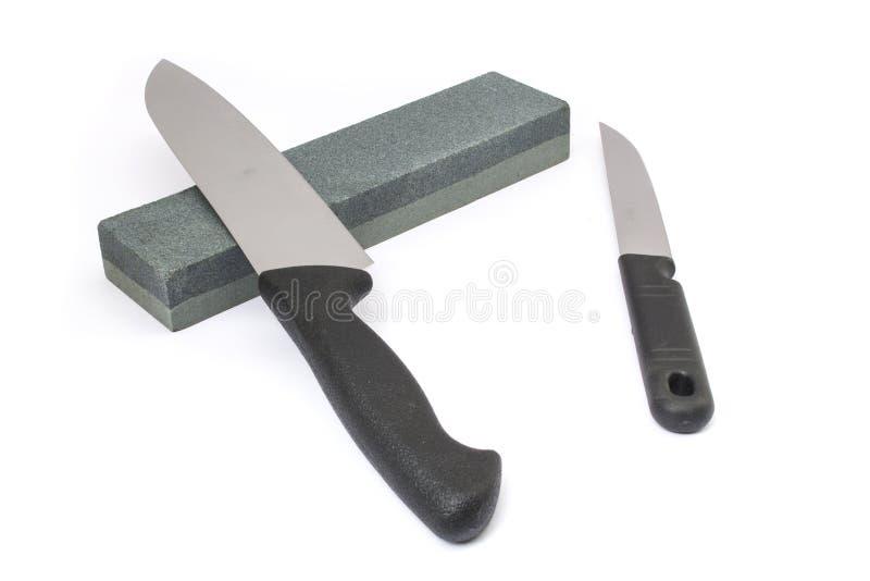 Knife and whetstone stock photos