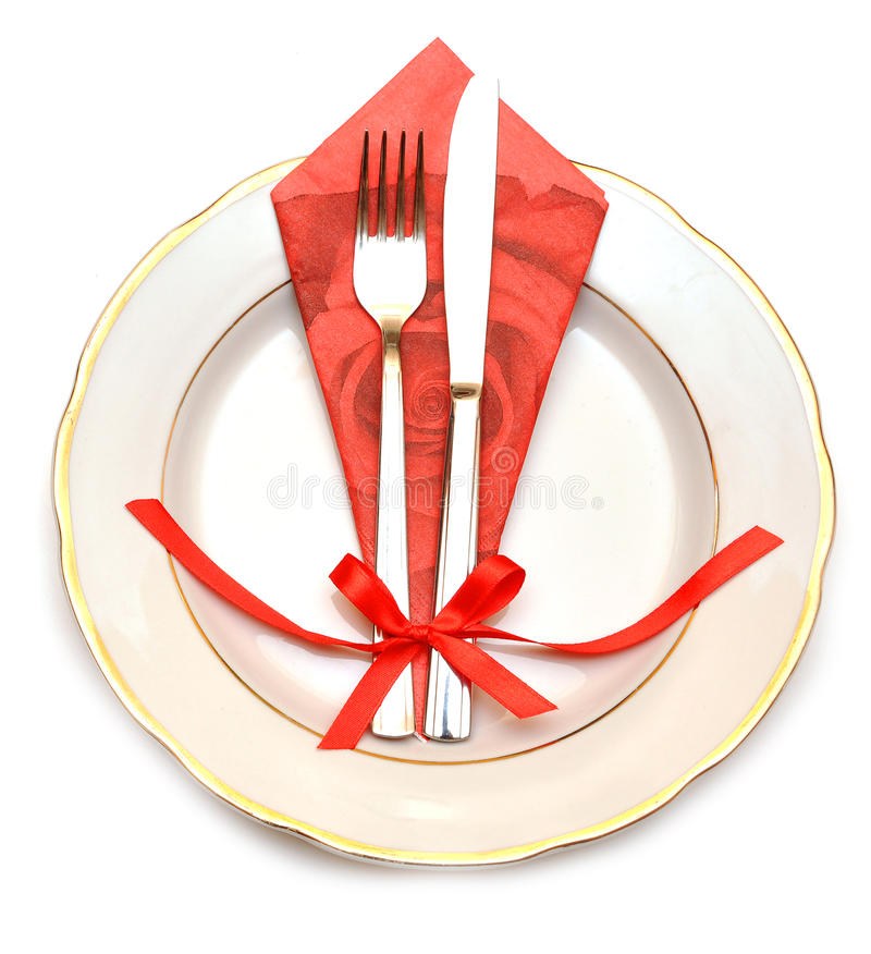 Knife, white plate and fork. On white background stock photos