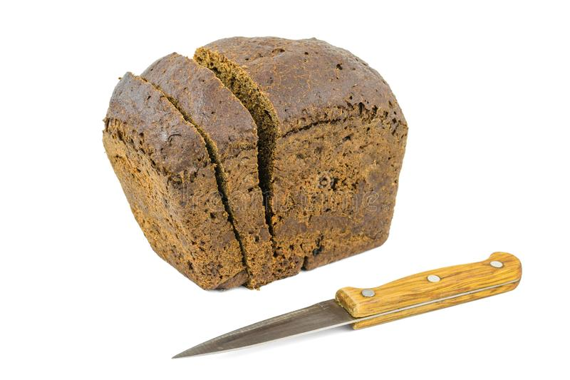 Knife with wooden handle and bread made of coarse flour isolated on white background. royalty free stock photo