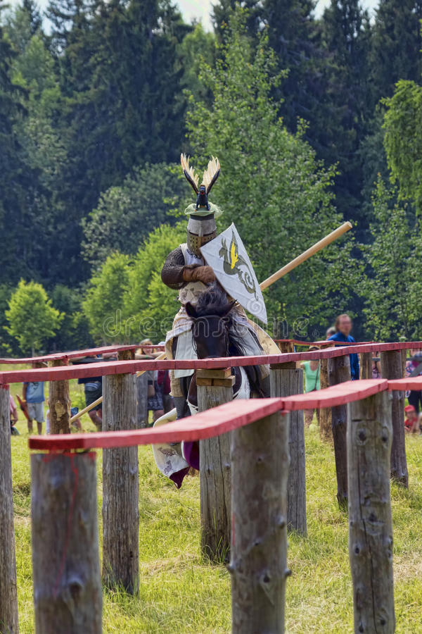 The knight on a dark horse royalty free stock photos
