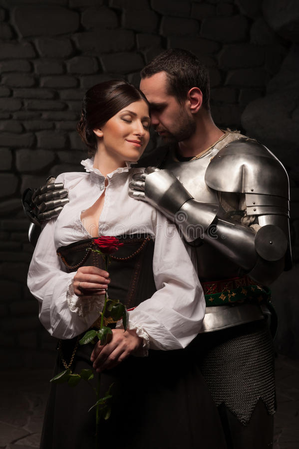 Knight giving a rose to lady stock image