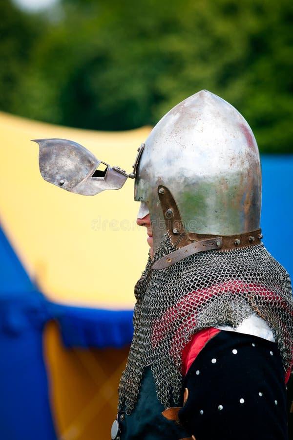 Knight with helmets visor open stock photo