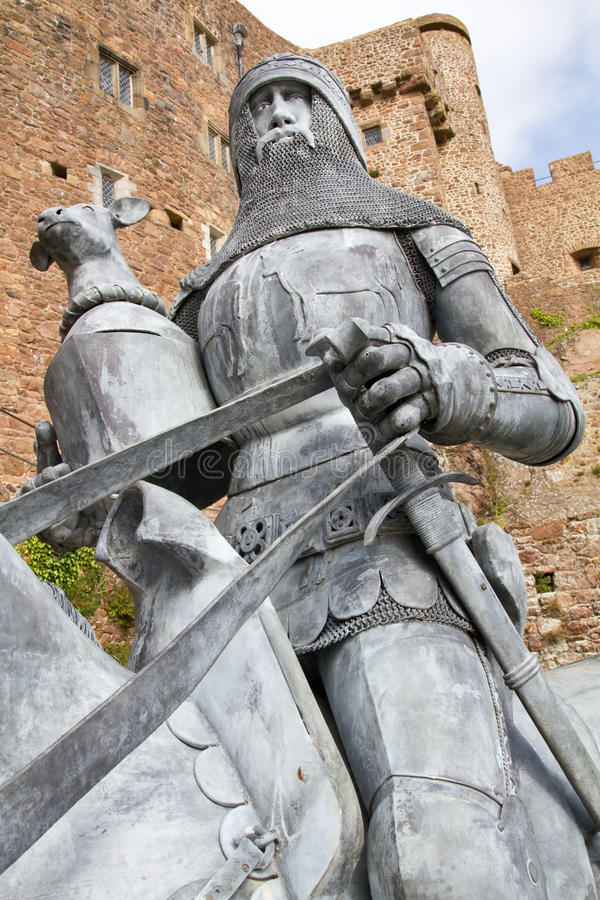 Knight with horse in front of a castle royalty free stock photos