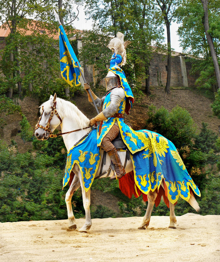 Medieval Knight Horse Riding, Prague Castle. Medieval Knight - horse riding in historic costume at Prague Castle. Czech Republic royalty free stock image
