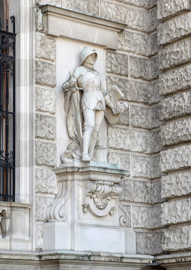 Knight in Prachtrustung or Armor by Stefan Schwartz, Neue Burg or New Castle, Vienna, Austria. Pictured is one of twenty statues on the façade of the Neue royalty free stock image