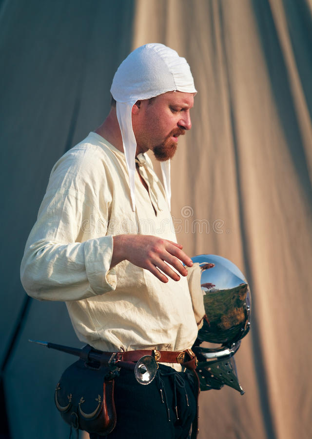 Knight prepares for a battle stock images