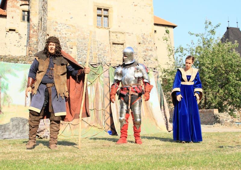 Knight, princess and servant stock image