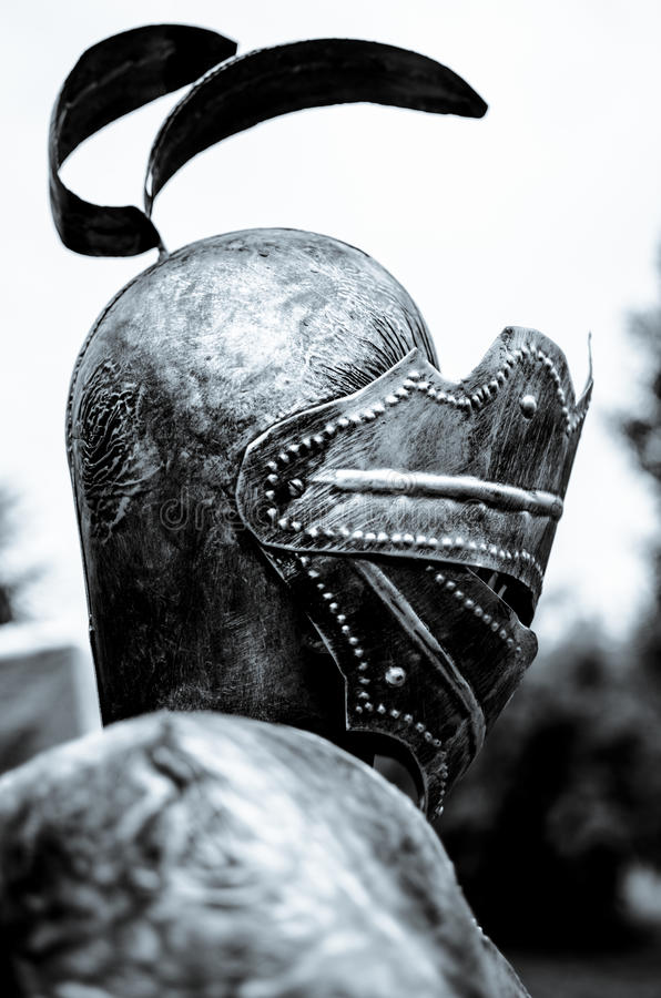 Knight profile. Knight with metal armor side view stock photo