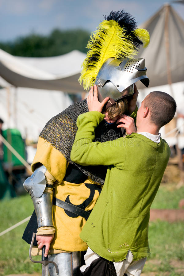 Knight removing the helmet royalty free stock image