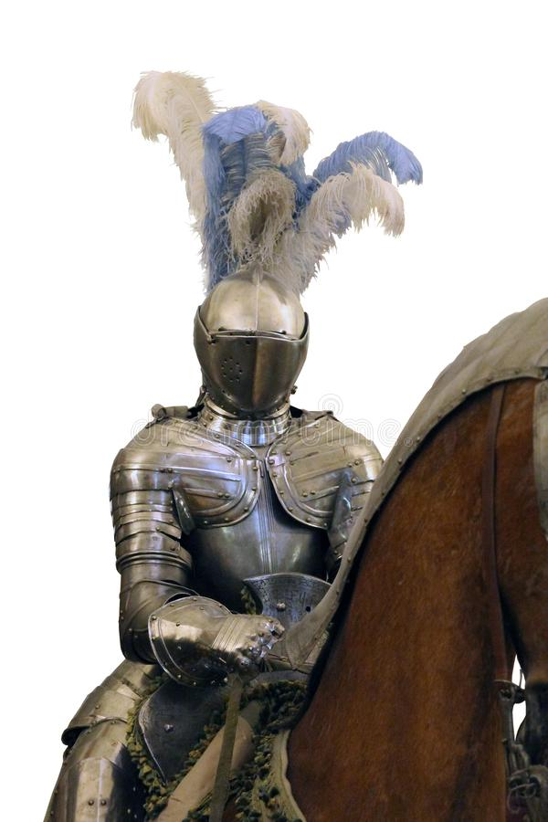 Knight in shining steel armor and a helmet with feathers on the horse isolated stock photos