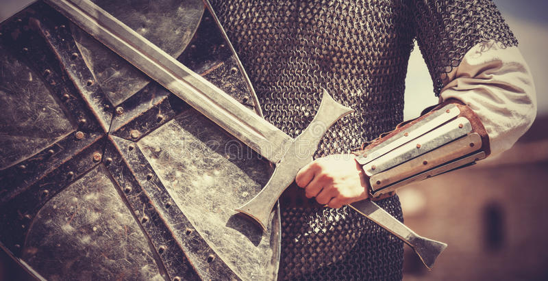 Knight with sword and shield stock photography