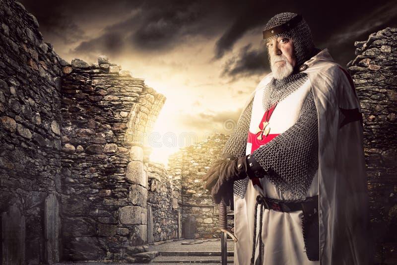 Knight Templar. Posing near some ruins stock photo