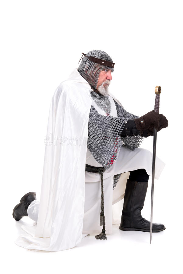 Knight Templar. Praying isolated in white stock photography