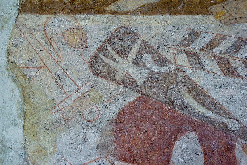 Knight with Thor`s hammer on the shield and a Norman sword. Medieval fresco. In Hojen church, Denmark, July 16, 2015 stock image