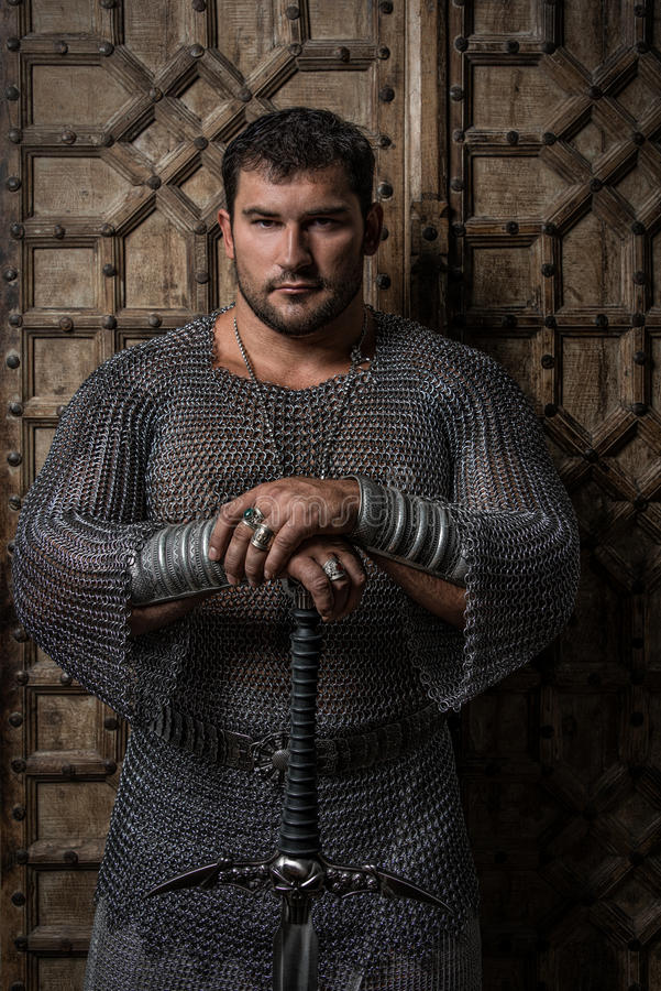 Knight wearing chain mail. And holding a long sword royalty free stock photos